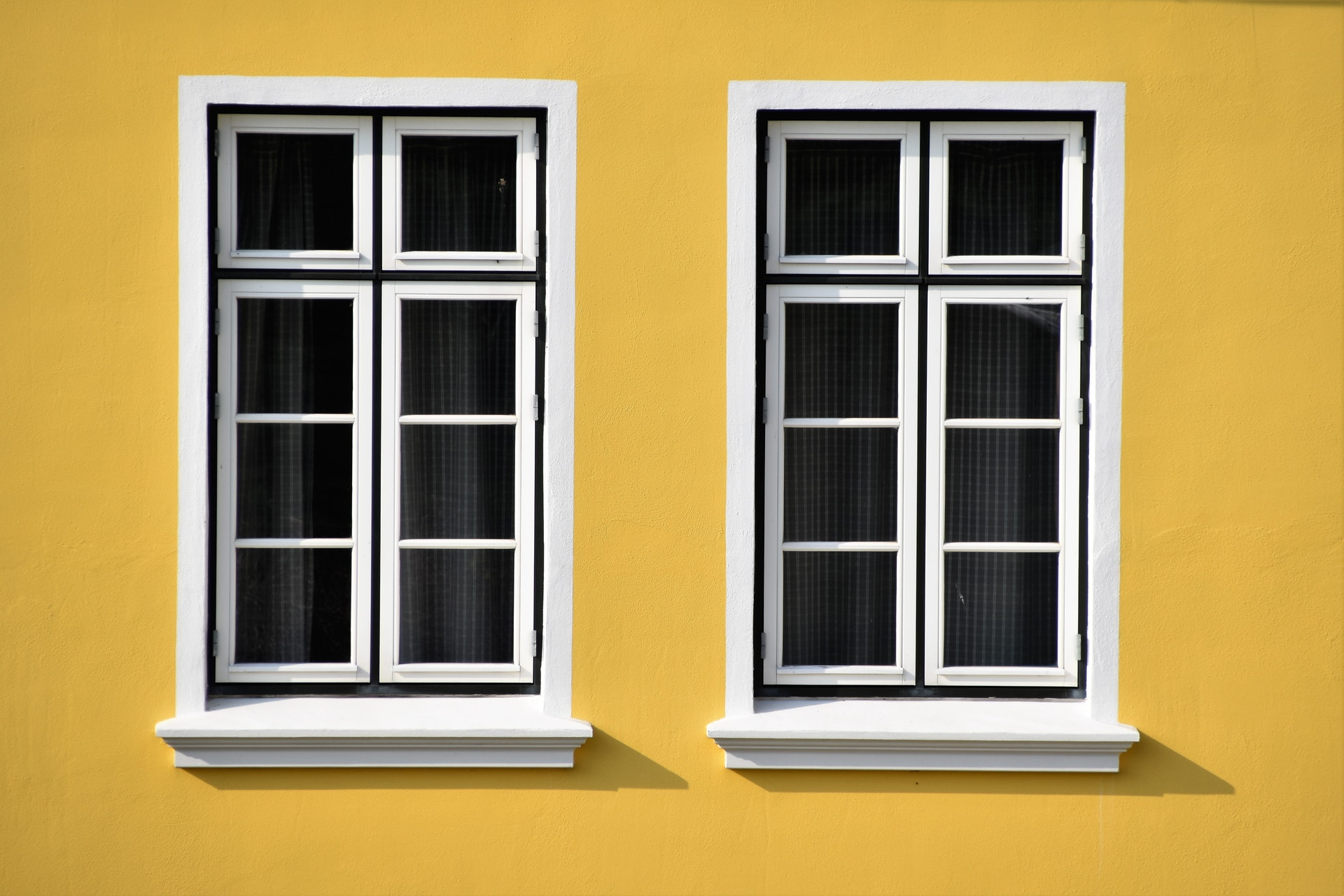 closed-white-wooden-framed-glass-windows-2290609.jpg
